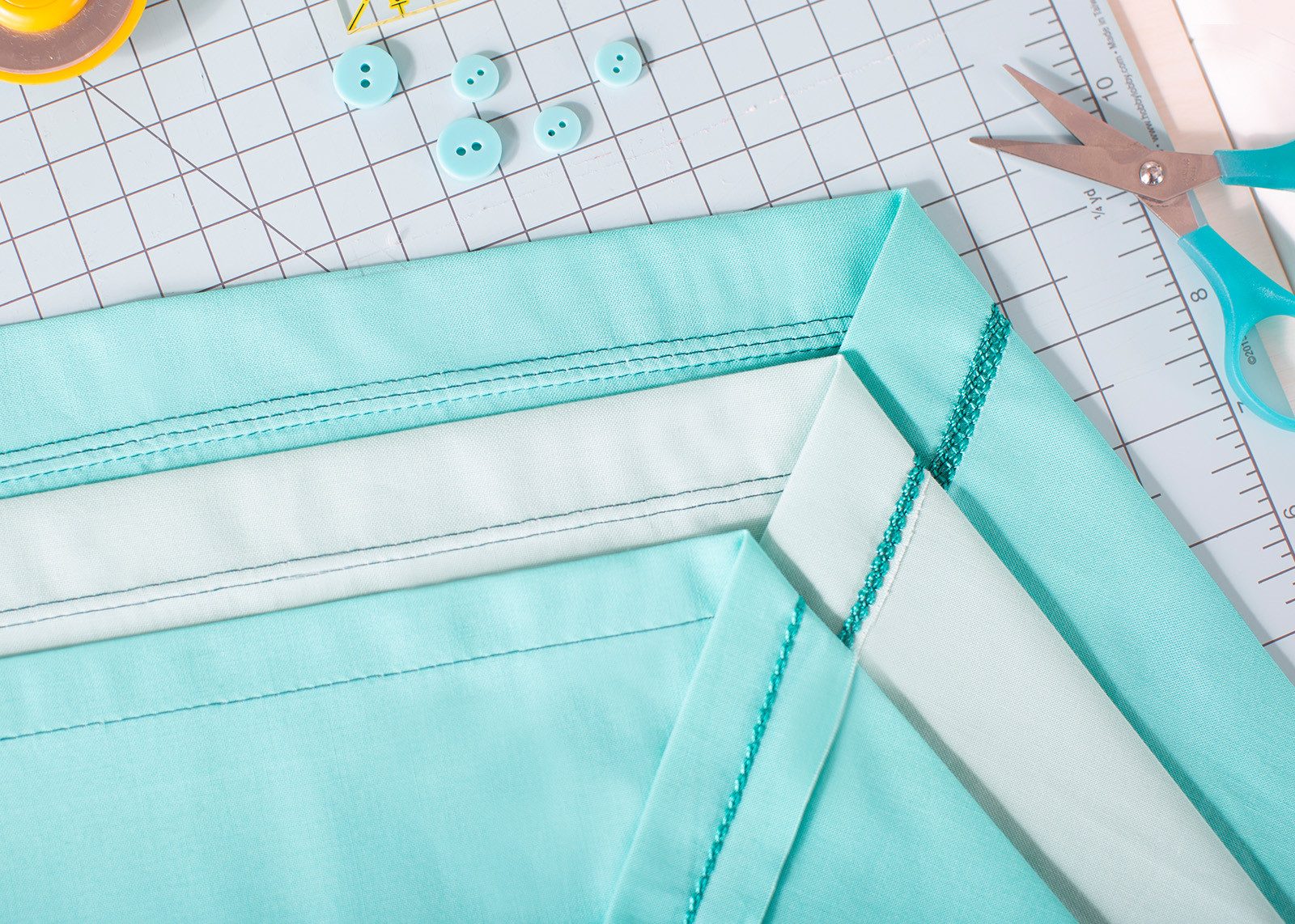 Baby Lock Euphoria Cover Stitch Serger Sewing Machine creates professionally finished hems and seams.